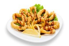 Deep Fried Calamari Rings with lemon Royalty Free Stock Photo
