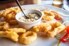Deep fried calamari rings with sauce bowl Royalty Free Stock Photos