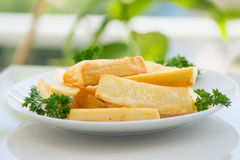 Deep fried cassava. / yuca frita.  The Cassava root is peeled, boiled, then deep fried.  Served as a side dish Stock Photo
