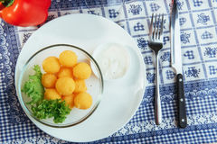 Deep fried cheese balls with lettuce and sauce Stock Image