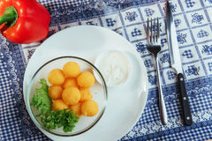 Deep fried cheese balls with lettuce and sauce Stock Images