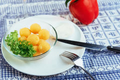 Deep fried cheese balls with lettuce and sauce Stock Photography