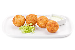 Deep fried cheese balls with lettuce and sauce. Royalty Free Stock Photo