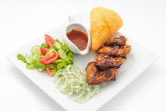 Deep fried chicken with crisp loaf and spicy sauce Royalty Free Stock Photo