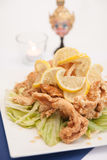 Deep fried chicken with honey and lemon sauce. stock image
