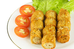 Deep fried chicken roll. Deep fried chicken roll  with tomto and lettuce on white plate Stock Photography