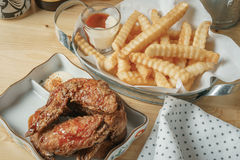 Deep fried chicken wing and french fries stock photos