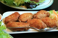 Deep fried chicken wings with fish sauce stock images