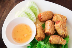 Deep Fried Crab Meat Rolls. Served on white plate on wooden table royalty free stock photos