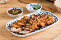 Deep Fried Crispy Pork Belly Cooked with Garlic and spicy dippin Royalty Free Stock Photo