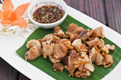 Deep fried crispy pork with spicy sauce. Stock Photos