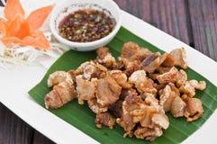 Deep fried crispy pork with spicy sauce. Stock Photos