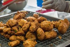 Deep fried Curry paste ocean fish or Fish curry pancake in Taling Chan Floating Markett at Bangkok, Thailand. Deep fried Curry paste ocean fish or Fish curry royalty free stock images
