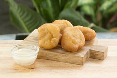 Deep fried dough bun with sweetened condensed milk Stock Image