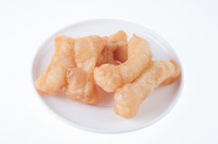 Deep fried dough stick on background Royalty Free Stock Photos