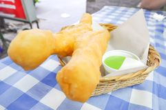 Deep-fried dough stick. With dip Royalty Free Stock Image
