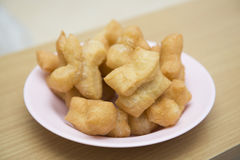 Deep-fried dough stick on dish Royalty Free Stock Photography