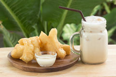 Deep fried dough stick and ice coffee Royalty Free Stock Photography