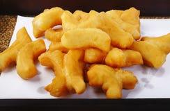 Deep fried dough stick Stock Photos