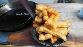 Deep fried dough stick in kios shop Bangkok Thailand stock photos