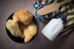 Deep fried dough sticks and fresh milk royalty free stock images