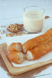 Deep fried dough sticks with a glass of hot soy bean milk. Fry bread stick or `you tiao` in chinese Stock Photography