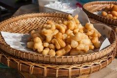 The Deep Fried Doughstick on bamboo basket. Stock Photos