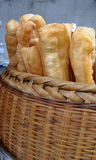 Deep-fried doughstick in basket Royalty Free Stock Photography