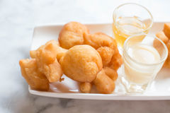 Deep-fried doughstick. And coffee on table,Thai breakfast Stock Photography