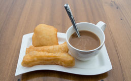 Deep-fried doughstick and coffee ,Thai breakfast Royalty Free Stock Photos