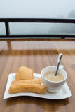 Deep-fried doughstick and coffee ,Thai breakfast Royalty Free Stock Photo