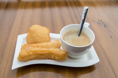 Deep-fried doughstick and coffee ,Thai breakfast Royalty Free Stock Photography