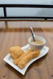 Deep-fried doughstick and coffee ,Thai breakfast Stock Image
