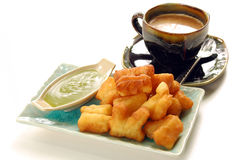 Deep-fried doughstick with local coffee Royalty Free Stock Photo