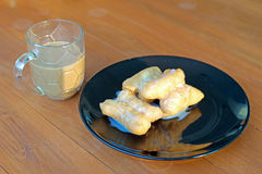 Deep fried doughstick with sweetened condensed milk and coffee Stock Image