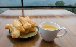 Deep-fried doughstick and tea ,Thai breakfast Royalty Free Stock Photo