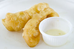 Deep-fried doughstick on white plate Stock Photos