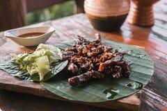 Deep fried dried deer meat on banana leaf. royalty free stock image
