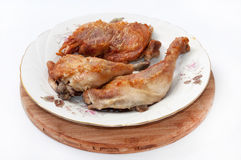 Deep fried drumstick and thigh on a white plate Royalty Free Stock Images