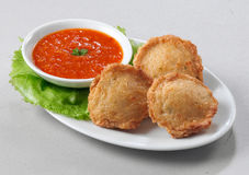 Deep fried dumplings. A plate of deep fried dumplings with chili Royalty Free Stock Photos