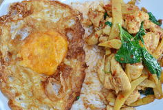 Deep-fried egg and curry chicken with bamboo shoot Royalty Free Stock Photography