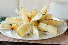 Deep fried eggplant in tempura coating Stock Photos