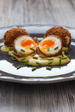 Deep-fried eggs with mustard sauce Royalty Free Stock Photography