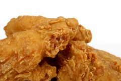 Deep fried fast food, spring chicken in golden lemon batter Royalty Free Stock Photography