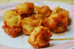 Deep fried fish ball dressing chili sauce and wooden stick Stock Photo
