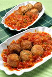 Deep fried fish balls in vegetable sauce Royalty Free Stock Photography