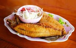 Deep fried fish. With fish sauce stock photos