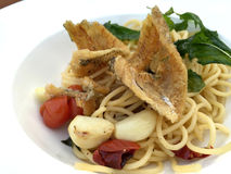 Deep fried fish with garlic and dried chili spaghetti Royalty Free Stock Photo