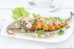 Deep fried fish with harbal salad sauce Royalty Free Stock Images