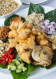 Deep fried fish with Herb salad. Thai  healthy food, Deep fried fish with Herb salad and peanut sweet sauce Stock Images